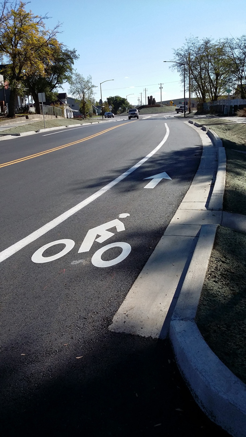 A two-lane road with a bike lane on it